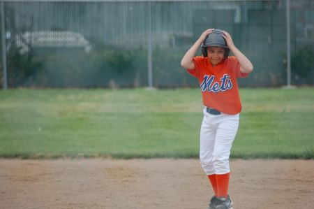 Photo of K and K playing baseball in 2009.