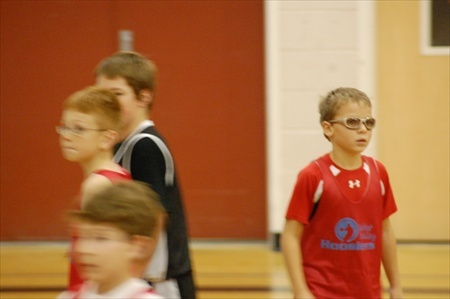 Photo of Konner and Kayden playing basketball in 2011.