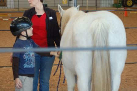 Photo of Ben at horse therapy.